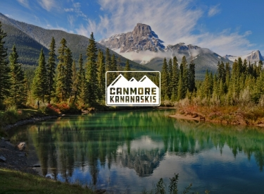Canmore Kananaskis logo over mountains