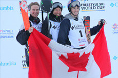 skiers holding Canadian flag