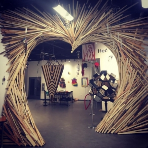 A wooden archway sculpture at artsPlace Canmore